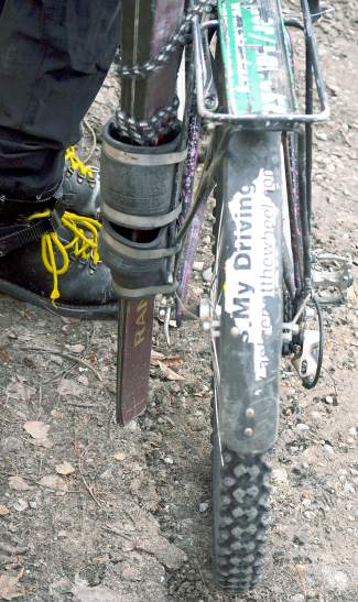 The homemade ski rack attached to an old-school bike rack on Doc PJ's Shasta mountain bike. He crafted the rack for about $10: the price of pipefittings and bungee cords.