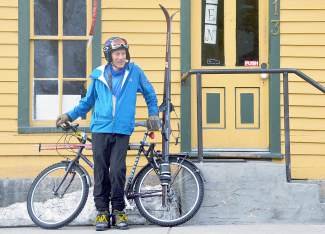 Craig Louis Perrinjaquet, aka Doc PJ, in front of Amazing Grace in downtown Breckenridge with his Shasta mountain bike and homemade ski rack. In the rack are his 1980 Rossignol Randonee touring skis, a pair he bought from