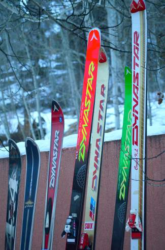 C.J. Mueller's collection of vintage Dynastar race skis, including the pair of Course KLs he wore to break the world speed skiing record in 1987 (far right).