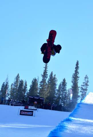 Chase Blackwell of Longmont gets inverted during the USASA Revolution Tour halfpipe qualifier at Copper Mountain on Dec. 2. Blackwell took first overall in the men's snowboard open division (96.50).