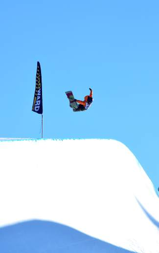 Gus Shuler of Wisconsin tosses a massive method on the first hit of his run during the USASA Revolution Tour halfpipe qualifer at Copper Mountain on Dec. 2. Shuler took 8 out of 13 competitors in the men's snowboard open division.