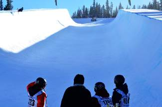 Competitors watch on as a skier airs out of the halfpipe at Copper Mountain during the USASA Revolution Tour qualifer on Dec. 2.