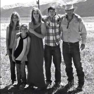 This 2012 photo provided by the Johnson family shows Dawna Johnson, 45, third left, and Dwayne Johnson, 46, right, with their children, from left, Kiowa-Rain Johnson, 18, Gracie Johnson, 13, and Dakota Johnson, in front of Mount Princeton in Colorado. Dwayne, Dawna and Kiowa-Rain Johnson were killed in Monday's Sept. 30, 2013, rockslide near Buena Vista, Colo. Gracie Johnson was rescued from the rubble and hospitalized in Denver. Also killed were Baigen Walker, 10, and Paris Walkup, 22, both of Birch Tree, Mo. They were nephews of Dwayne and Dawna Johnson. (AP Photo/Johnson Family)