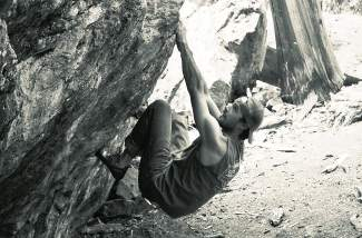 Local climber Jordan Lynch begins in a sit start at Montezuma Boulders, found near routes like Alpenglow Wall and Haus Rock.