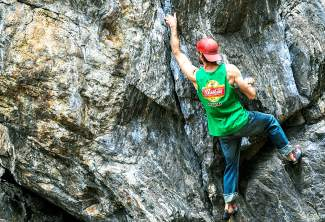 Jordan Lynch of Breckenridge during an autumn climbing session on the V0-V7 problems at Montezuma Boulders.