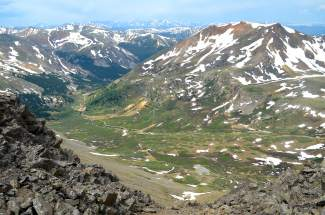 The view from the ridgeline leading to Grays Peak from the Argentine Pass trailhead. Few hikers try to summit Grays (14,278 feet) and Torreys (14,275 feet) from the Summit County side, thanks in part to tricky sections of scree and few trail markers.