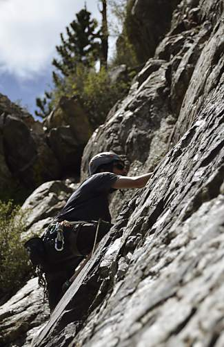Frank Bowman on a climbing route at White Cliff, a popular area in Summit County.
