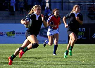 Summit's Cassidy Bargell breaks through the Chaparral defense to score a try during the first half of the Tiger's 64-7 win at Infinity Park in Denver Saturday to claim their eighth straight state title.