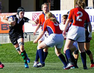 Summit carries the ball downfield during the first half of the Tiger's 64-7 win over Chaparral to claim the Colorado state rugby title at Infinity Park in Denver Saturday.
