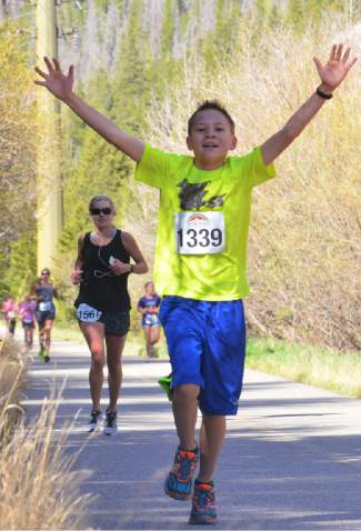 One of the youngest runners at 2016 Run the Rockies on June 4 celebrates about a mile before the finish line on Main Street Frisco. The 40th anniversary of the June 10K and half marathon drew more than 400 runners from across Colorado and the West.