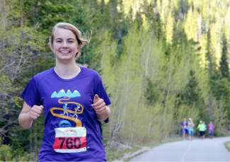 A young runner powers through the final mile of the 10K course between Copper and Frisco at the 2016 Run the Rockies road race on June 4. The 40th anniversary of the June 10K and half marathon drew more than 400 runners from across Colorado and the West.