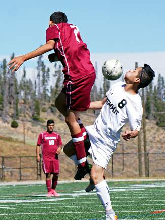 Summit High's Gerson Martinez (8) and Palisade's Eric Payan (2) battle for control of a loose ball during the first half of the Tiger varsity team's 3-0 win on Sept. 19.