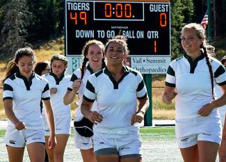 The Summit High School varsity rugby team is all smiles after defeating Palmer 49-0. The match was called at the half.