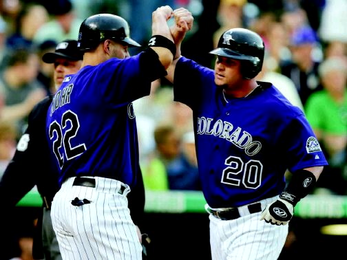 65fe471c AP PhotoColorado Rockies' Todd Greene, right, is congratulated by teammate  Dustan Mohr as Greene crosses home plate after hitting a two-run home run  to ...