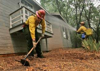 Private firefighters with Wildfire Defense Systems in Paradise, Calif., demonstrate the services their company provides, including creating defensible space, during 2008's wildfire season. Lake Dillon Fire Protection District announced last week it is providing free defensible space reviews for homeowners in the district.