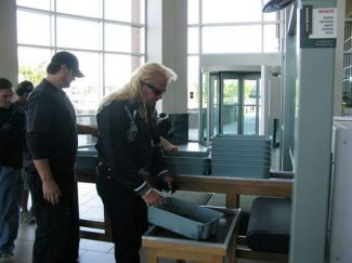 "Special to the Daily/National Institute of ScienceDuane ""Dog"" Chapman, the TV bounty hunter, checks in at the Mesa County courthouse."