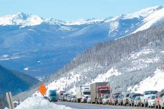 Eastbound I-70 traffic grinds to a halt in April 2013 near the Eisenhower Tunnel. CDOT recently reported 2013 traffic volume exceeded 2012 numbers.