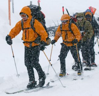 Members of the 304th Rescue Squadron leave the parking lot at Timberline on their way up the slopes of Mt. Hood Tuesday Dec. 15, 2009, to make an assessment of the avalanche danger and to practice their avalanche training as they wait for better weather to continue the search for two missing climbers.   (AP Photo/The Oregonian, Brent Wojahn)  ** MAGS OUT, NO SALES **