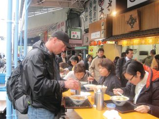 Vail Daily/Lauren GlendenningRyan Leland eats noodle soup with the locals at a streetfront eatery in Tokyo, near the Tsukiji Fish Market. In Japan, it is customary and totally acceptable to pick up a bowl of soup and slurp the broth straight from the bowl.