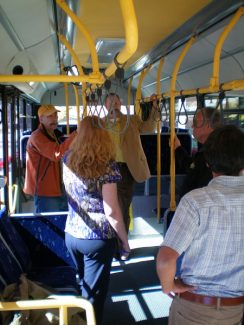 Special to the Daily/Town of BreckenridgeTown officials inspect the interior of a refurbished bus. Below, before the ribbon cutting.