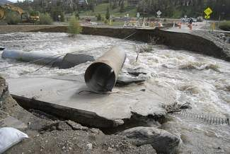 Coyne Valley Road washed out in 2011 when a rain event caused the Blue River to flood. With record snowpack still covering the mountains surrounding Summit County, local officials are bracing for what could be another year of significant flooding.