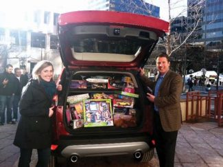 Special to the Daily Frisco business-y consultant dude David Cunningham helped stuff a Ford Escape full of toys for Summit County's Family & Intercultural Resource Center (FIRC) last week in Denver. Joining him at the toy drive was Shawna Sullivan with Ford Motor Co.