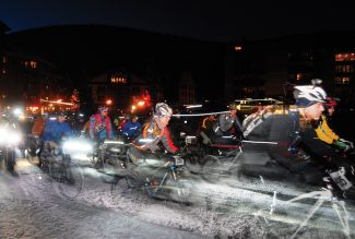 Cyclists numbering 150 take off from Copper Mountain for the innaugural Winter Mountain Bike Race Saturday evening, Jan 14 (2012). The 10-mile Copper En Fuego course consisted of two 5-mile loops at the base of the mountain including East Village and through the Burning Stones Plaza. The Cloud City Wheelers cycling club in Leadville will host the entire nighttime Winter Mountain Bike Race Series.