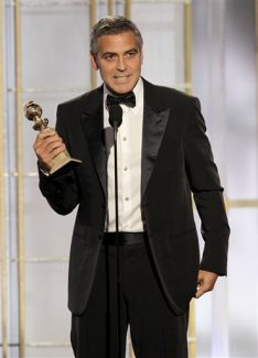 """In this image released by NBC, George Clooney accepts the award for best actor for his role in """"The Descendants"""" during the 69th Annual Golden Globe Awards on Sunday, Jan. 15, 2012 in Los Angeles. (AP Photo/NBC, Paul Drinkwater)"""