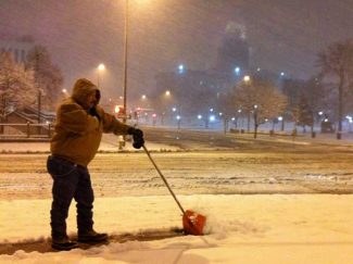 (Daniel J. Schneider, The Denver Post)As heavy snow falls on the State Capitol around 2 a.m. Friday, Juan Macias begins the daunting task of shoveling the accumulation from around Pioneer Monument Fountain at the corner of Colfax Ave. and Broadway in Denver.