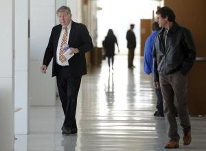 Douglas Bruce walks toward courtroom 4H at the Lindsey-Flanigan Courthouse in Denver for his sentencing hearing on tax evasion charges. Kathryn Scott Osler, The Denver Post