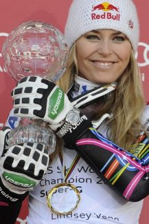 Lindsey Vonn, of the United States, shows the trophy of the alpine ski, women's World Cup super-G discipline title, in Schladming, Austria, Thursday, March 15, 2012. (AP Photo/Keystone, Jean-Christophe Bott)