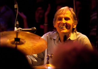 "In this May 15, 2010 photo, Levon Helm plays drums with the Levon Helm Band during a Ramble at Helm's barn in Woodstock, N.Y.  Helm, who was in the final stages of his battle with cancer, died Thursday, April 19, 2012 in New York.  He was 71.  He was a key member of The Band and lent his distinctive Southern voice to classics like ""The Weight"" and ""The Night They Drove Old Dixie Down.""  (AP Photo/Times Herald-Record,John DeSanto)"