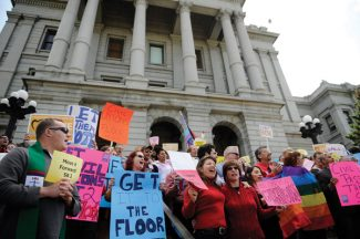 "Civil unions supporters held rally on the West Steps of the State Capitol, Tuesday, May 8, 2012, in Denver.  Chants of ""shame on you"" from gay rights supporters thundered through the Colorado House on Tuesday night after Republican House Speaker Frank McNulty said legislation to allow civil unions won't get a vote.  (AP Photo/The Denver Post, RJ Sangosti)  MAGS OUT; TV OUT; INTERNET OUT"
