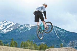 special to the daily/Kay BeatonMichael Gollnick of Breckenridge flies through the Frisco Bike Park last week. The park is open and operational for the 2012 season.