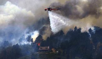 Crews fight the High Park fire from the air as it continues to grow near homes in an evacuation area just northwest of Horsetooth Reservoir, Monday, June 11, 2012, near Fort Collins. RJ Sangosti, The Denver Post