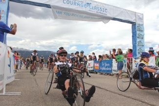 Special to the Daily/Children's Hospital ColEach year, the Courage Classic culminates with Team Courage crossing the finish line. Team Courage mainly comprises current and former Children's Colorado patients, faculty, family and friends. Isaac Sargent is the boy on the left using a hand-crank bicycle.