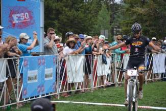 Vail's Jay Henry crosses the finish line first at a past Firecracker 50 race. The annual mountain bike tour of Breckenridge singletrack and double-track regularly draws local and regional pros for a Fourth of July tradition.