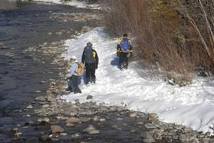 Daily file photo Search and Rescue teams walk along the shoreline of the Blue River in Silverthorne looking for information and clues near the area where the body of Stephanie Roller Bruner was found in November, 2010.