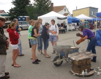 Special to the Daily/Dan PociusPat Pocius demonstrates raku pottery firing at last year's Fairplay Bead & Fiber Show. This year's raku demo takes place at 11 a.m. Sunday and shows how the small beads and focal pieces are fired.
