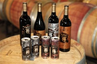 This Friday, Aug. 3, 2012 photo shows Infinite Monkey Theorem wine in cans and bottles at the winery in Denver. Last year the winery started selling some of its wine in slim, handheld aluminum cans, the better for active Colorado drinkers to tuck its wines away for a sip while skiing, camping, fishing, hiking, rafting or biking. (AP Photo/Ed Andrieski)