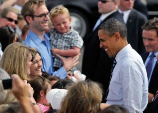 President Barack Obama smiles as he shakes hands with supporters as he arrives at Fort Collins-Loveland Municipal Airport, Tuesday, Aug. 28, 2012,  in Loveland, Colo. (AP Photo/Jack Dempsey)