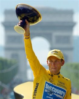 FILE - In this July 24, 2005, file photo, Lance Armstrong holds the winner's trophy after claiming his seventh straight Tour de France cycling race during ceremonies on the Champs-Elysees avenue in Paris after the 21st and final stage of the race between Corbeil-Essonnes, south of Paris, and the French capital. U.S. Anti-Doping Agency chief executive Travis Tygart said Thursday, Aug. 23, 2012, that the agency will ban Armstrong from cycling for life and strip him of his seven Tour de France titles for doping. Armstrong on Thursday night dropped any further challenges to USADA's allegations that he took performance-enhancing drugs to win cycling's premier event from 1999-2005. (AP Photo/Bernard Papon, Pool, File)