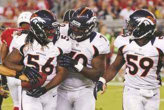 Denver Broncos' Nate Irving (56) celebrates his fumble recovery against the Arizona Cardinals with teammates  Malik Jackson and  Danny Trevathan (59) during the first half of a preseason NFL football game Thursday, Aug. 30, 2012, in Glendale, Ariz.(AP Photo/Ross D. Franklin)
