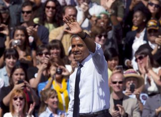 President Barack Obama waves after speaking at a campaign rally in Golden, Colo., Thursday, Sept. 13, 2012. (AP Photo/Ed Andrieski)