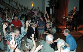 Special to the DailyDooWop Denny packs the dance floor every year at the Silverthorne Pavilion. Here, folks are gettin' down to 'YMCA.'