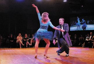 Summit Daily/Mark FoxJake Fiala swings his way around the dance floor with professional dance partner Channing Cooke on his way to winning the fourth annual Dancing with the Mountain Stars in 2011.