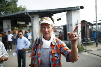 American Glen Plake, survivor of a weekend avalanche at Mount Manaslu in the Himalayas arrives at the Tribhuwan domestic airport  in Katmandu, Nepal, Wednesday, Sept. 26, 2012. Rescuers have so far brought down the bodies of eight victims, four French, one each from Germany, Italy and Spain, and a Nepali guide. The climbers killed were part of a crush of mountaineers who came to the peak in Nepal because of heightened tensions between Chinese authorities and Tibetans. (AP Photo/Niranjan Shrestha)
