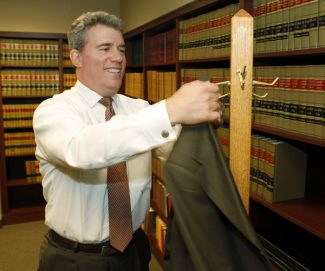 This photo taken Sept. 21, 2012, shows Colorado Secretary of State Scott Gessler in his office in Denver. Republican election officials who were swept into office on promises to root out voting fraud say they're doing just that.  But they're not finding much so far. After some digging, state officials in key presidential battleground states have found only a tiny fraction of the illegal voters they initially suspected. Searches in Colorado and Florida have yielded numbers that are less than one-tenth of 1 percent of all registered voters in either state.  (AP Photo/Ed Andrieski)