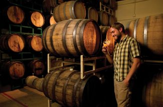 Chad Yakobson owner/brewer of Crooked Stave Artisan Beer Project with his barrels of beer on Sept 12 at his northwest Denver headquarters and tasting room.