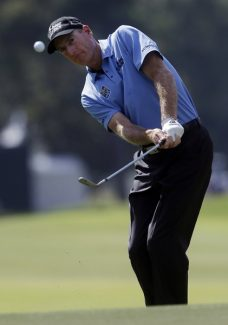 Jim Furyk chips to the green on the 12th hole during the second round of play in the Tour Championship golf tournament in Atlanta on Friday, Sept. 21, 2012.  (AP Photo/John Bazemore)